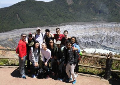 Team taking a picture by volcano in Costa Rica