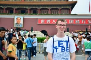 Kevin poses in front of the Forbidden City in Beijing, China as a member of the first All-American Model UN team in 2012.